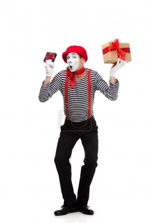 mime grimacing and holding present boxes isolated on white