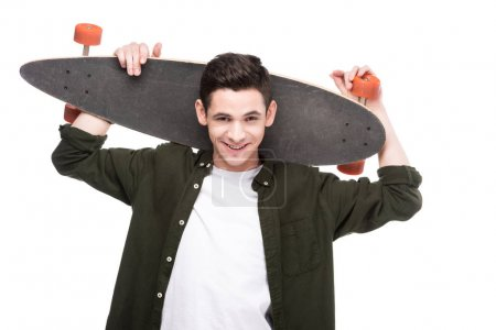 Photo for Smiling skateboarder holding longboard behind head isolated on white - Royalty Free Image