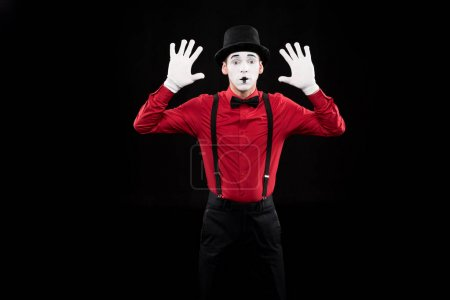 mime with hands up isolated on black