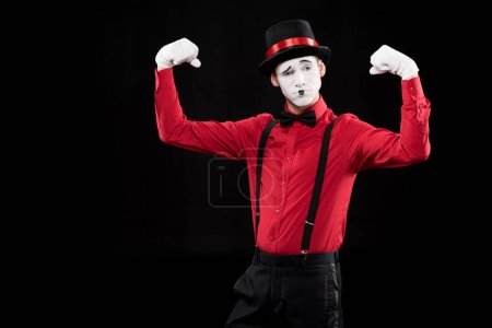 mime showing muscles isolated on black
