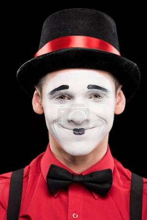 portrait of smiling mime with makeup isolated on black