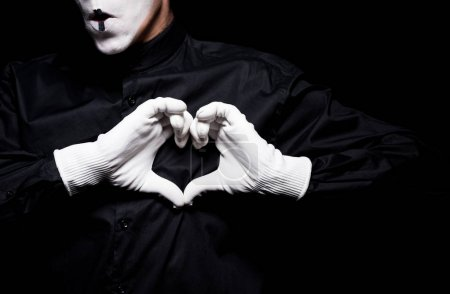 Photo for Cropped image of mime showing heart with hands isolated on black, st valentines day concept - Royalty Free Image