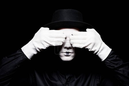 mime covering eyes isolated on black