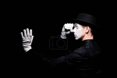mime pretending looking in spyglass isolated on black