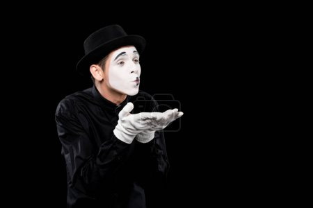 mime sending air kiss isolated on black