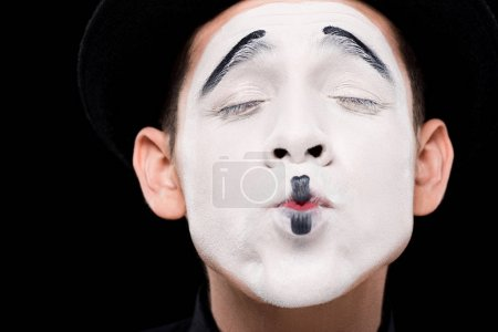 Photo for Mime showing kiss with closed eyes isolated on black - Royalty Free Image
