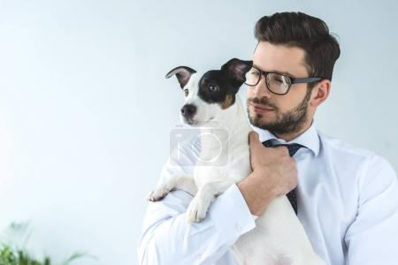 bearded businessman holding jack russell terrier dog