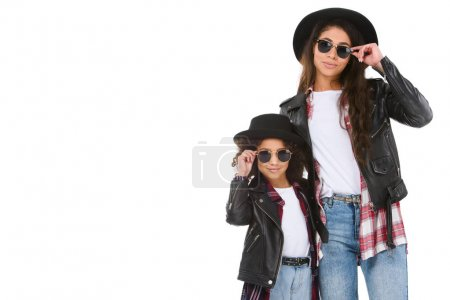 stylish mother and daughter in leather jackets and sunglasses looking at camera isolated on white