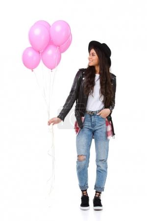 attractive young woman in leather jacket with balloons isolated on white