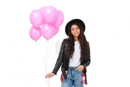 smiling young woman in leather jacket with balloons isolated on white