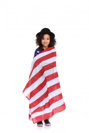 african american child in hat covered with usa flag isolated on white