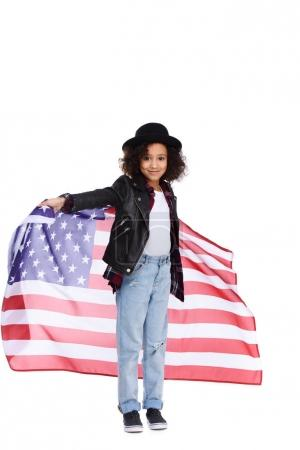 beautiful little child in stylish hat and leather jacket with usa flag isolated on white