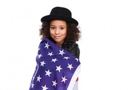 beautiful little child in hat covered in usa flag isolated on white