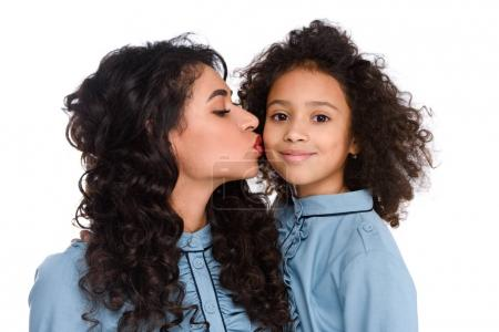 close-up shot of mother kissing her daughter isolated on white