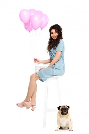 beautiful young woman with pink balloons and pug puppyisolated on white