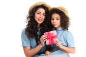 mother and daughter with pink gift box for mothers day isolated on white