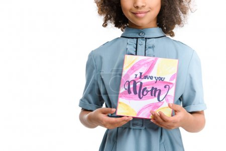 cropped shot of smiling little child with mothers day greeting card isolated on white