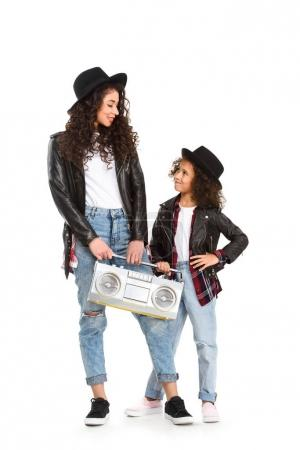 stylish mother and daughter with vintage boombox isolated on white