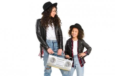 happy mother and daughter with retro boombox isolated on white