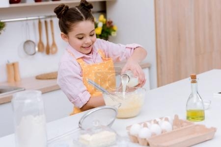 Photo for Happy little child mixing dough for pastry - Royalty Free Image