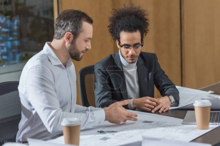 Photo for Successful architects discussing building plans at office - Royalty Free Image