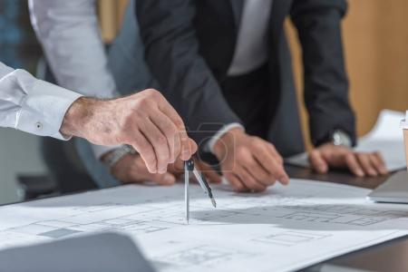 Photo for Cropped shot of architects using compass for building plans - Royalty Free Image