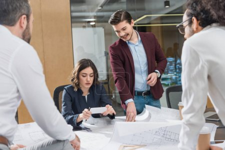group of architects working together on building plans at office