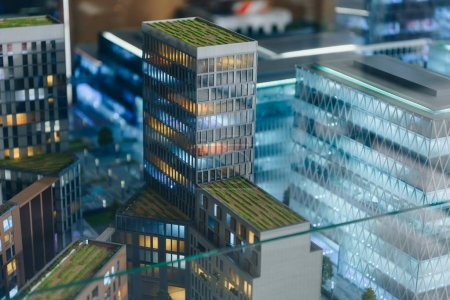 close-up shot of plastic miniature model of modern city under glass