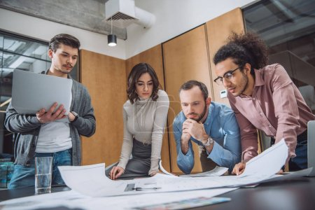 Photo for Group of thoughtful architects working together at office - Royalty Free Image