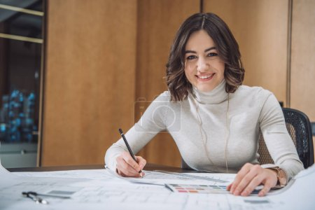 smiling young designer choosing color from palette