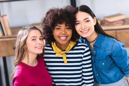 portrait of cheerful multiracial students looking at camera