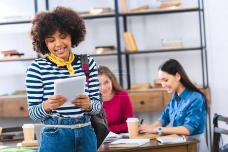 selective focus of african american student using tablet