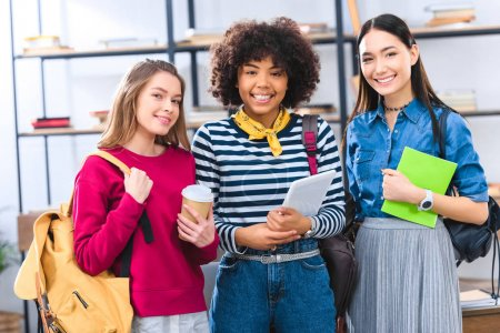 portrait of smiling multiethnic students with backpacks