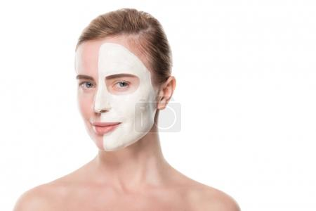 Woman with facial skincare mask on half face isolated on white