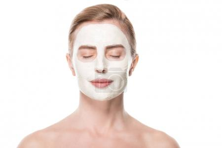 Portrait of closed eyes woman with facial skincare mask isolated on white