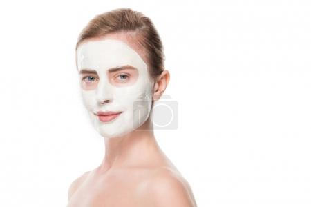 Portrait of woman with facial skincare mask isolated on white