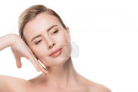 Female with clean skin touching own face isolated on white