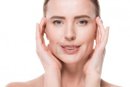 Female with fresh clean skin touching own face isolated on white
