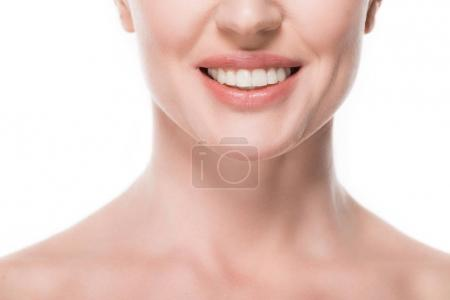 Cropped view of smiling woman with clean skin isolated on white