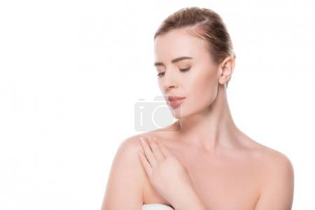 Female with clean skin touching own shoulder isolated on white