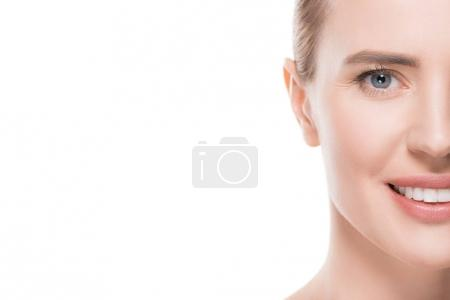 Cropped image of smiling woman with clean skin isolated on white