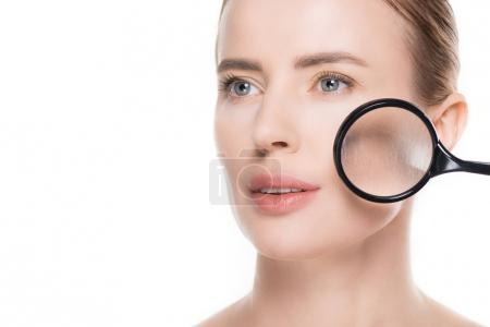 Magnifier on face of woman with clean skin solated on white