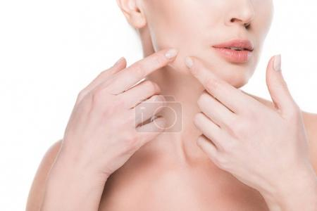 Cropped view of female touching own face by fingers isolated on white