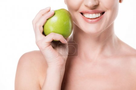 Cropped view of smiling female with clean skin holding apple isolated on white
