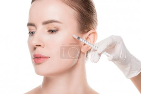 Photo for Beautician hands doing injection in woman cheek isolated on white - Royalty Free Image