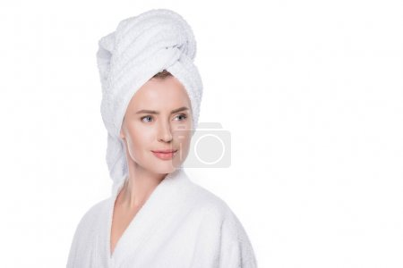 Woman with clean skin in bathrobe and towel on hair isolated on white
