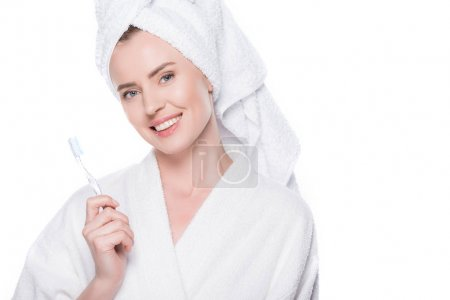 Smiling woman with clean skin holding toothbrush isolated on white