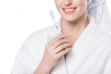 Cropped view of smiling female with tootbrush in hand isolated on white