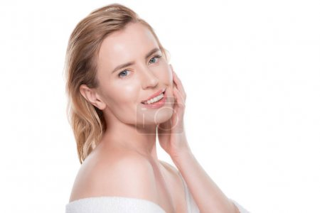 Woman with clean skin touching own face isolated on white