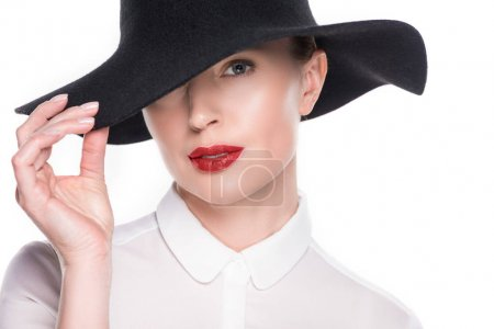 Woman with hidden eye under hat isolated on white